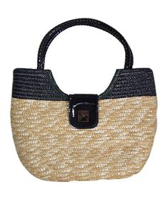 LOVE it!!!      Conjuring the image of a perfect, sunny day, this sophisticated straw tote is just the thing to flaunt along the boardwalk. A magnetic snap closure opens to reveal a lined interior where three separate pockets help organize essentials.15'' W x 11.5'' H x 5.5'' DStraw / PVCImported