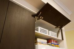 Overhead cabinet above the fridge for extra storage. www.thekitchendesigncentre.com.au