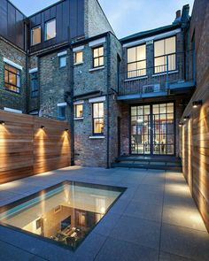 Cemented brick wall for exteriors with yellow lighting and concrete tiling on floors for industrial theme of exteriors