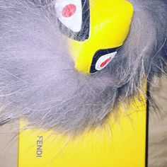 Fur monster keychain So cute yellow and grey fur monster keychain! Really makes a bag pop. Real fur FENDI Accessories Key & Card Holders
