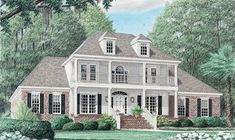 This large 4 bedroom Southern Home has a grand entrance with porch and balcony.  Southern House Plan # 241013.