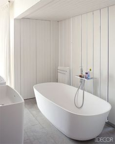 The tub and sinks in the master bath are by Antonio Lupi.