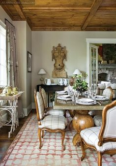 Love this ceiling with the wood of the chairs & the table base.