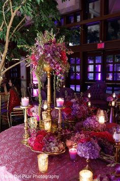 Love the tall centerpiece, but with more orange flowers instead of the red