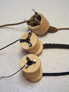 Some more knitting spools - hey knitting nancy!  miniature loom knitting to create cord.  cute!