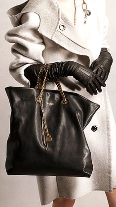 Gloves? Hmmmm  //  Lanvin Pre-Fall 2014 handbag and gloves http://www.vogue.com/fashion-week/