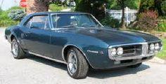 1967 Pontiac Firebird. Overhead Cam 6 cylinder with 4 barrel carburetor. Split headers. Automatic trans. Black interior.