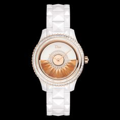 """Dior VIII Grand Bal """"Plume"""" model, 38mm, automatic movement """"Dior Inversé 11 ½"""" calibre, oscillating weight in pink gold decorated with fawn-coloured feathers and set with diamonds, white ceramic and pink gold case and bracelet, bezel set with baguette-cut diamonds and a white mother-of-pearl ring, crown set with a rose-cut diamond, white mother-of-pearl dial, anti-reflective sapphire crystal glass, opalescent case-back. Limited edition of 88 pieces. Discover more on www.dior.com"""