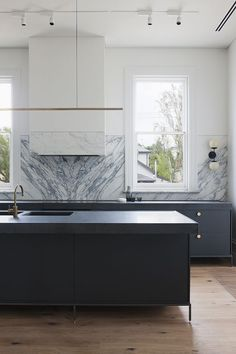Source: Hecker Guthrie via Dust Jacket Ok ok, one more from the Hecker Guthrie crew. How AWESOME is this kitchen? I'm totally digging the two toned kitchen worktop and coincidentally I've been thinking about doing this in my own place. I like it...