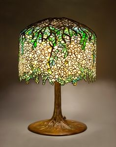 LOUIS COMFORT TIFFANY, Wisteria Table Lamp, before or in 1901, stained glass, 18 inch shade and 27 inch base, Tiffany Studios: The Holtzman Collection Exhibition, Model #342 - Designed by Clara Driscoll.