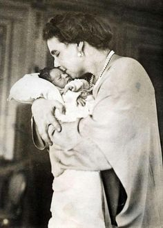 Prince Peter of Yugoslavia in the arms of his grandmother, Queen Marie of Romania. 1923.