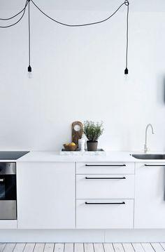 Minimalistic white kitchen via Blackbird