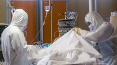 Medical staff of the Intensive Care Unit of the Casalpalocco Clinic in the outskirts of Rome tend to patients, Wednesday, March Domenico Stinellis/AP Kai, Economic Terms, Health Ministry, Intensive Care Unit, Medical Assistant, Yorkie, At Least, Death, Positivity