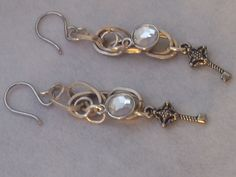 chains and crosses with a silver drop charm