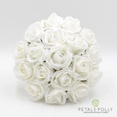 This white bridesmaids posy is made with quality foam roses, crystal stems, diamanté rose centres and ribbon bow. We can make a complete matching range in this design and colour.  Size – Choose your preferred size above.  We can make all of our products in all of our colours or can be made to your own size, design and colours. Please use the Request a Custom Order link above.  Please see more of our range at our Etsy store: https://www.etsy.com/uk/shop/PetalsPollyFlow...
