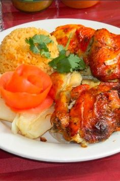 Half chicken, rice, and beans at Casa Adela. | 21 Delicious NYC Foods That Are Worth Every Penny