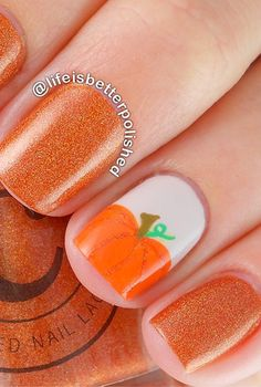 15 Spooktacular Halloween Nail Art Ideas: The matching glittery orange polish rounds out this fall-ready mani featuring a pumpkin accent nail. Get the easy step-by-step tutorial to creating small pumpkins.