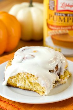 Soft and fluffy spiced pumpkin cinnamon rolls with cream cheese frosting- a fall favorite!