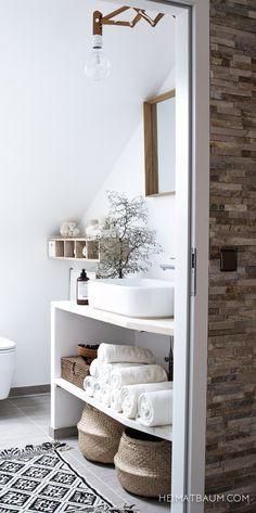 Bathroom, sink with space under on shelves ideal for towels and bathroom centrals More