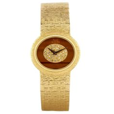 Piaget Yellow Gold Diamond Tiger's Eye Wristwatch | From a unique collection of vintage wrist watches at https://www.1stdibs.com/jewelry/watches/wrist-watches/