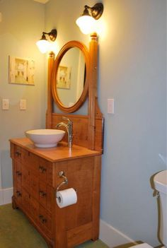 Victorian vanity with a vessel sink.