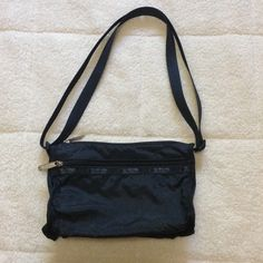 LeSportsac small crossbody Small size in black. View last picture to see the comparison LeSportsac Bags Crossbody Bags