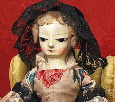Early carved wooden doll