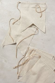 Linen Bunting Inspiration. Some pics show tassel/ribbon hanging down between the flags. anthropology