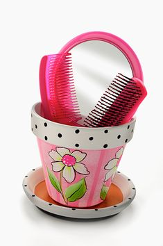 Terra cotta flower pot turned into storage for little girl's hair grooming supplies by Chris Williams.  Instructions included.