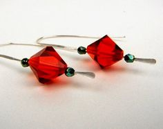 Christmas earrings of large red glass beads