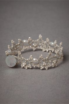Carolingian Bracelet from BHLDN. Love the look of this bracelet. It's very delicate, almost like lace, and the pearls in the beading are extremely sweet.