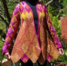 This is a pretty awesome pattern and I think I would do a color scheme very similar to this Ravelry: knittywood's Coat of many colors