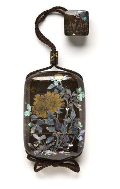 A four-case Somada-style inro 19th century Decorated on a roiro ground with peonies and butterflies in inlaid mother-of-pearl, e-nashiji and hirame, interiors nashiji and fundame; fitted with a lacquered cylindrical ojime designed with butterflies in gold and silver hiramakie and a hako netsuke with a cicada in a landscape in inlaid mother-of-pearl