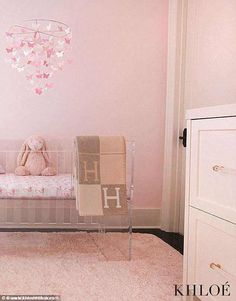 Another look: Another photo saw a pink bunny sitting inside a clear crib underneath a $49 ...