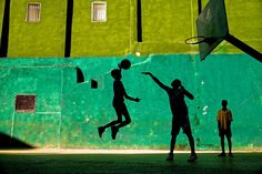 MARCH 12, 2018 ONE ON ONE Young boys play basketball after school in Havana, Cuba. While not quite as popular as baseball, basketball has a long history in Cuba. The national team even won an Olympic bronze medal in 1972. PHOTOGRAPH BY JEREMY LASKY, NATIONAL GEOGRAPHIC YOUR SHOT