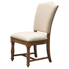 Perfect pulled up to your kitchen or dining room table, this classic side chair showcases linen upholstery and nailhead trim.   Product:...