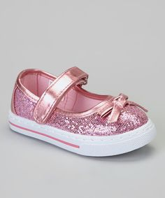Somewhere over the rainbow, tiny twinkling toes are smiling! These glittery, bow-accented sneakers transform little darling's feet into magical delights, ready to cast a happy spell onto any outfit.Hook and loop closureMan-madeImported