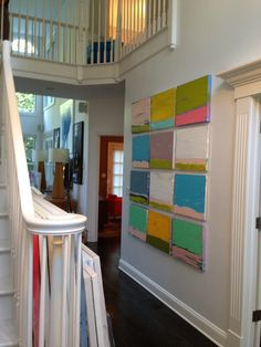 Lively entry hallway, thanks to this deceptively simple arrangement. Great colors!
