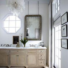 This bathroom had us at the Venetian glass chandelier. Tap the link in bio to peek inside this home. | Photo: @richardpowersphoto; Design: Lynn Myers & @michaelmber #edbathrooms  #Regram via @elledecor