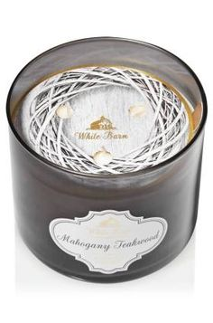 13 Fireplace-Scented Candles That Look as Great as They Smell mahogany teakwood