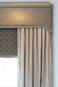 Upholstered cornice with nail head trim. IKEA Kvartal hardware for curtains can be hidden within.
