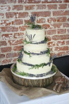 'Naked' wedding cake with dried lavender and fresh rosemary.                                                                                                                                                     More