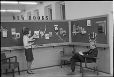 319462PD: Cheryl Perney and Mr Bamford at the new books display, State Library of Western Australia, 1966  https://encore.slwa.wa.gov.au/iii/encore/record/C__Rb3430634