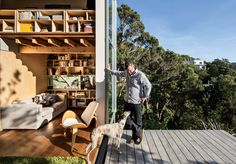 Oriented to absorb the afternoon sun, floor-to-ceiling doors comprise two-thirds of the home's west-facing walls, which open to an elevated deck overlooking Island Bay. Small Space Living, Small Spaces, Small House Decorating, Modern Door, Japanese Design, Prefab, Loft, Indoor Outdoor, Outdoor Decking