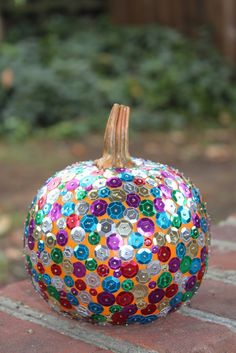 -- Sequins and straight pins in a foam pumpkin--
