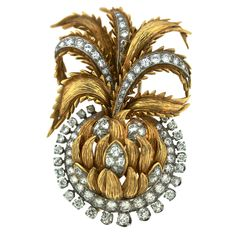 "DAVID WEBB Diamond Pineapple Brooch Clip The hand finished gold brushwork lends and artistic air to this piece. Measures 2.25"" in height and 1.5"" in width. Approximately 87 diamonds are set in platinum with 18k yellow gold brushed leaves beautifully interspersed throughout. Signed WEBB 18k PlATINUM. Circa 1960s"