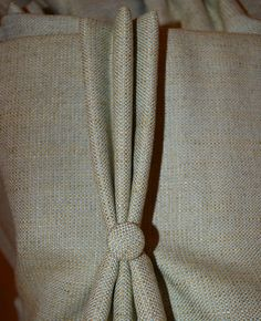 Triple pinch pleat headed curtains with matching buttons
