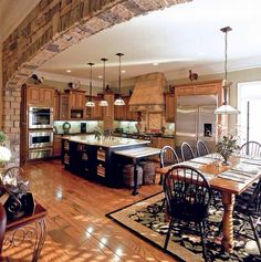 Love this country kitchen!! Really love the brick dividing wall ️<3