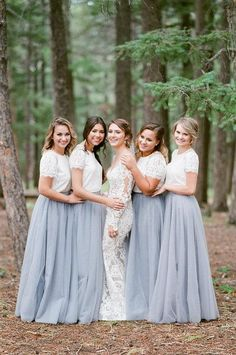 Long bridesmaid dresses with sleeves | Grey bridesmaid skirts with lace tops | Tulle modest bridesmaid gowns | Two piece bridesmaids dresses | Wedding Skirts |20 Ultra Romantic Tulle Wedding Ideas - Belle The Magazine #bridesmaids #bridesmaiddresses #bridesmaiddress #bridesmaid #weddings #boho #bohemian #bohemianwedding #bride #floral #weddingideas #weddinginspiration #bridesmaids #tulle