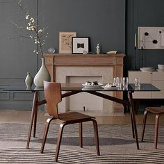 "Dover Dining Table. Glass top, truss-style wood legs. Solid wood legs with walnut-stained ash veneer; clear bevel-edge tempered glass top	76""w x 35.9""d x 30""h West Elm	$499"